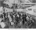 Mount Baker Improvement Club Christmas Meeting showing members seated at tables, Seattle, December...