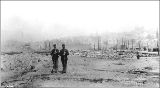 Aftermath of the Seattle fire of June 6, showing two members of the Washington National Guard, 1889