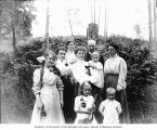 Moon family group portrait in front of ferns, Seattle, Washington, ca. 1910