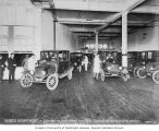 Service Department of the William O. McKay Company showing Ford automobiles and workers, Seattle,...