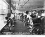 Mechanical Department of the William O. McKay Company showing men working on Ford automobiles,...