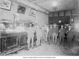 Saloon interior showing men standing at the bar, Occidental Ave. and Washington St., ca. 1895