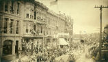 West side of 1st Ave. looking north from Cherry St. during July 4th celebrations, Seattle, 1888
