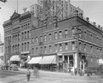 Hotels and businesses on the east side of 2nd Ave. S. and Washington St., ca. 1906