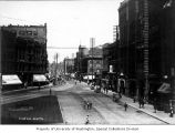 1st Ave. looking north from Yesler Way showing the Merchants National Bank and the Pioneer...