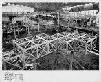 Winding passenger ramp and skeletal cubes under construction for the World of Tomorrow exhibit of...