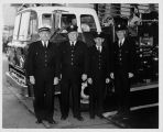 Members of the Seattle Fire Department in front of a fire truck at the Seattle World's Fair,...