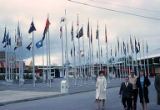 Fairgoers strolling past the Plaza of States at the Seattle World's Fair, April, 1962