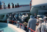Fairgoers and film crew gathered near the pool at the Pavilion of Electric Power, Seattle World's...