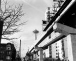 Monorail tracks under construction with Space Needle in background, Seattle, Washington, 1962
