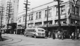 Bus in front of G.O. Guy Drugs on NE 45th Street looking west, University District, May 18, 1940