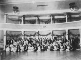 Large group of people in the hall on the second floor of the University National Bank building,...