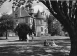 Students on the grass outside Denny Hall, University of Washington, ca. 1945