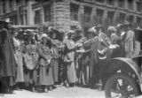 Gathering of men and women on downtown street, Seattle, ca. 1917-ca. 1920