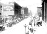 1st Ave. with Grand Pacific Hotel and advertisement for Yucatan Gum, Seattle, ca. 1917-ca. 1920