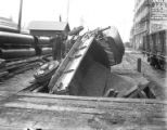 Wrecked truck from Pioneer Sand and Gravel Company on planked street, Seattle, ca. 1917-ca. 1920