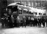 Conductors and group of people in front of streetcar X50 on the Seattle - Everett line, July 1910