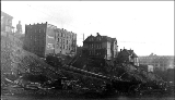 James St. between 4th and 5th Avenues looking south during the Denny Hill regrade, Seattle, March...