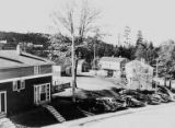 Exterior of homes and a row of parked cars, View Ridge neighborhood, Seattle, ca. 1942-1949
