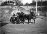 Seattle Fire Department Firehouse No. 20 horse-drawn hose wagon with fire station crew in...