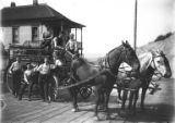 Seattle Fire Department Firehouse No. 20 horse-drawn hose wagon with fire station crew in driveway...