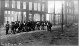 Aftermath of the Seattle fire of June 6, 1889 showing photographers with equipment in front of the...