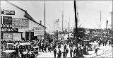 Crowds awaiting arrival of steamships at the waterfront, vicinity of Spring St., ca. 1897