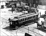 Puget Sound Traction, Light & Power Company car turning the corner at 4th Ave. and Jackson St....