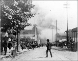 Start of the Seattle fire of June 6, 1889, looking south on 1st Ave.