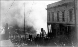 Start of the fire of June 6, 1889, looking south on 1st Ave. near Madison St.