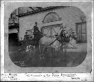 Captain J.L. Barch of the Seattle Police Department in horse-drawn wagon, 1892