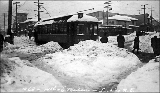 Streetcar at 14th Ave. and E. Madison St. after a snowfall, ca. 1915