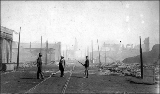Aftermath of the Seattle fire of June 6, 1889, showing the ruins of buildings and a member of the...