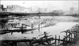 Aftermath of the Seattle fire of June 6, 1889 showing the waterfront at Western Ave. and Columbia...