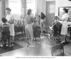 Edith Morgan and other hairdressers working on hair at Eastern State Hospital, Medical Lake,...