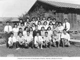 Japanese American men and women outside barracks, probably at the Tule Lake Relocation Center,...