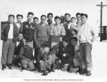 Japanese American men and boys in snow, probably at the Tule Lake Relocation Center, California,...