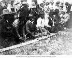 "Lummi Native American men playing ""slahal"" with drum and tally sticks, Bellingham,..."