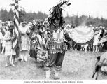 Man wearing thunderbird dance costume at a traditional Lummi Native American dance, Bellingham,...