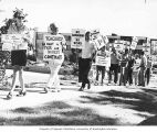 Teachers in a picket line at a protest at a Seattle School Board meeting, Seattle, September 27,...