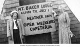 Two women standing next to a sign, probably near the entrance to Mt. Baker Lodge, June 9, 1950