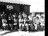 Group of the Legal Division outside the Legal Office, Minidoka Relocation Center, ca. 1943-1945