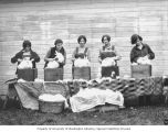 Five women shearing white rabbits, possibly Washington, ca. 1929-1932