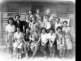 Faculty of Stafford School outside of office, Minidoka Relocation Center, ca. 1943-1945