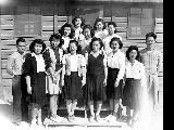 Group of the Statistics Section outside the office, Minidoka Relocation Center, Japanese evacuees,...