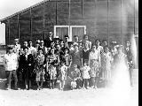 Group of men and women outside building, Minidoka Relocation Center, ca. 1943-1945