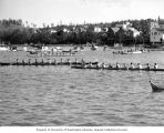 Two Native American long canoes getting into position to race at the Coupeville Native American...