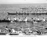 Eight Native American long canoes racing on the open water at the Coupeville Native American Water...