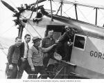 Five men standing in front of the Gorst airplane, before departing on a fishing trip, probably...