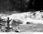 Man fishing from the rocks at Granite Falls, Washington, ca. 1929-1932